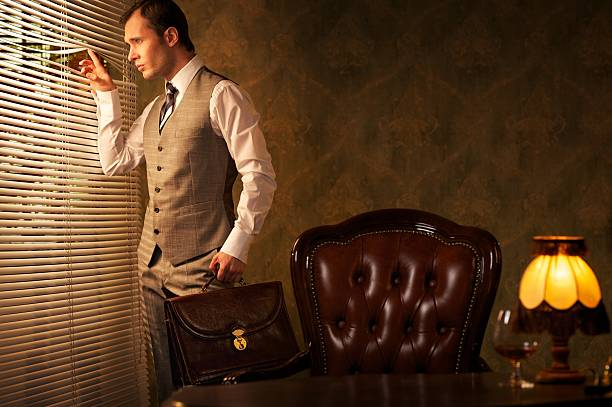 Retro man with a briefcase looking through jalousie. stock photo
