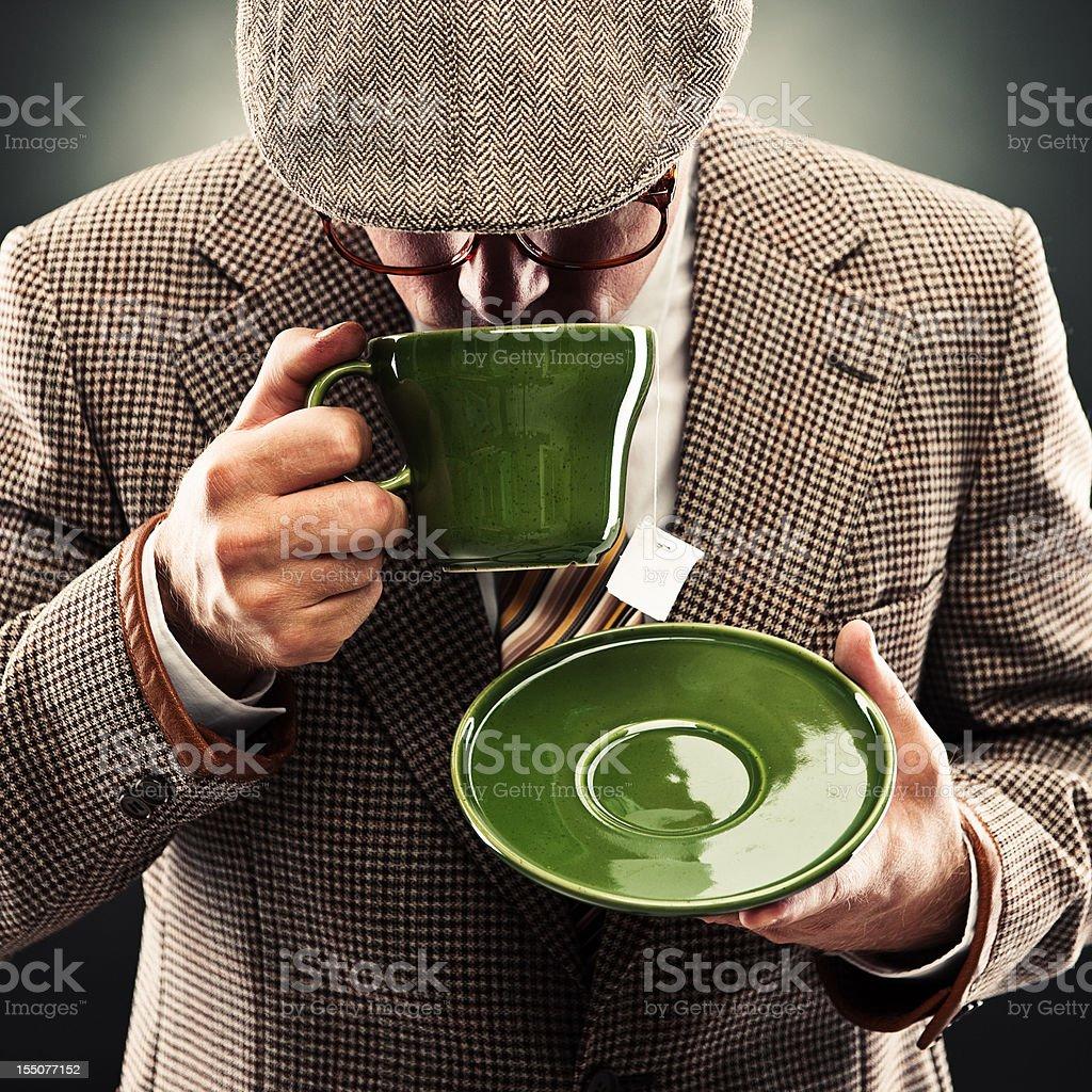 Retro man with tea stock photo