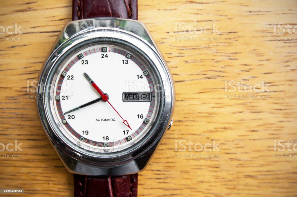 Retro men wrist watch on wooden background.Old men wrist watch stock photo