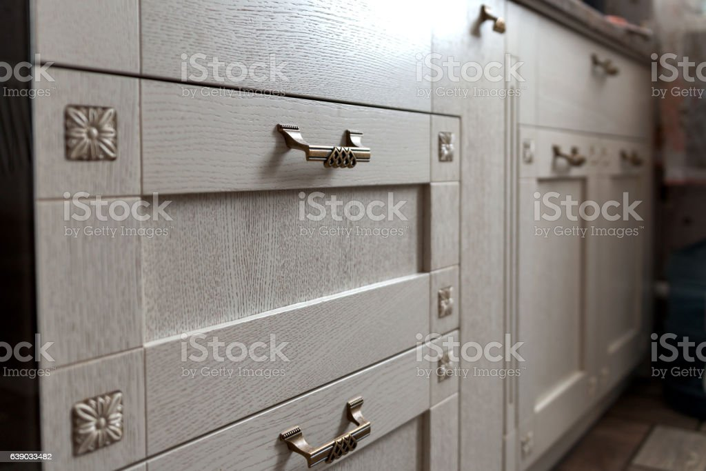 retro metal cabinet knobs in the kitchen stock photo
