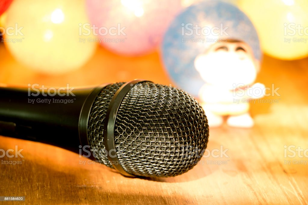 Retro microphone against blur colorful light restaurant background stock photo