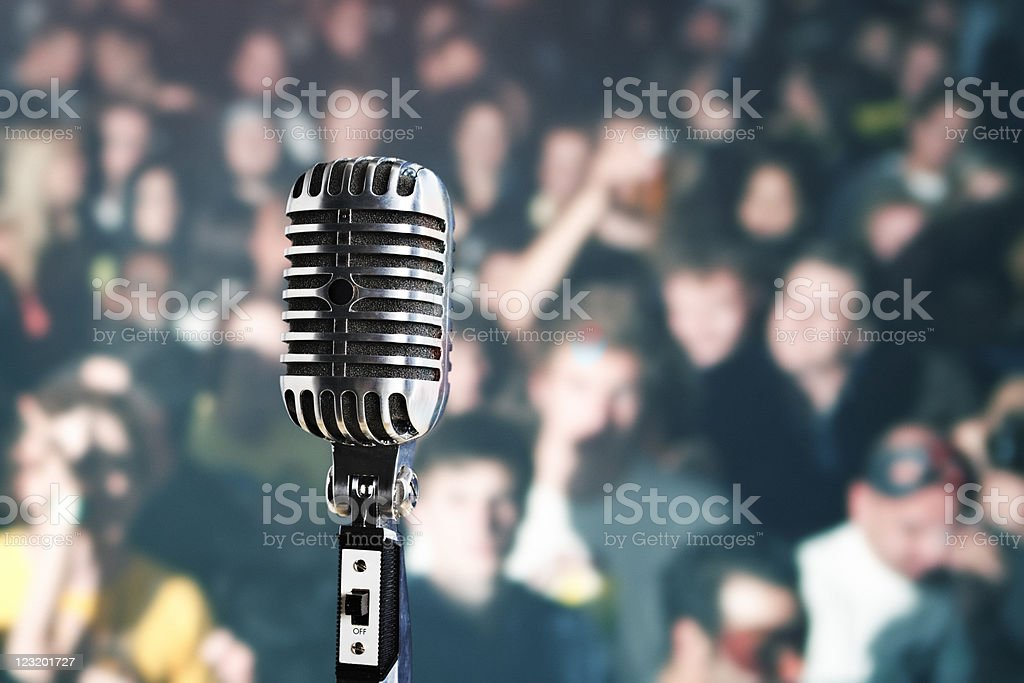 Retro microphone in front of audience stock photo
