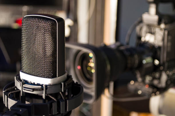 Retro microphone on stage a background of studio camera stock photo