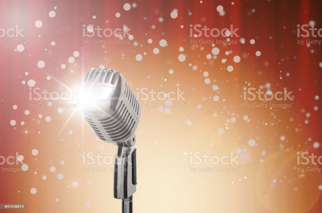 a6d2291e08fb3 Retro microphone over the Abstract photo of chrismas and blurred  background