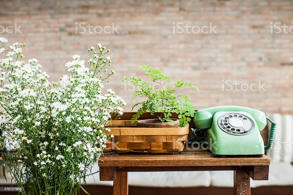 Retro mint green rotary telephone on wood table stock photo