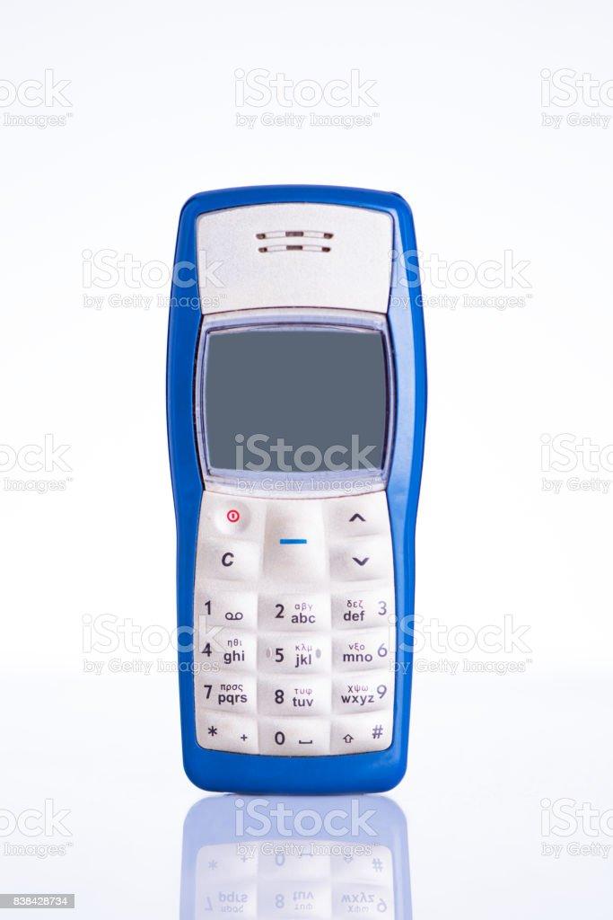 Retro mobile phone isolated on white background stock photo
