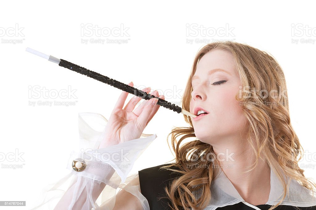 Retro Model is Smoking in Old Style Dress on White stock photo