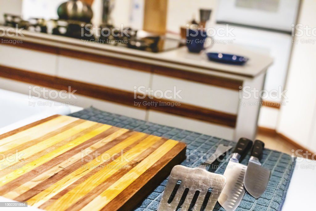 Retro Modern Kitchen Retro Modern Kitchen (Shot with Canon 5DS 50.6mp photos professionally retouched - Lightroom / Photoshop - original size 5792 x 8688 downsampled as needed for clarity and select focus used for dramatic effect) Apartment Stock Photo