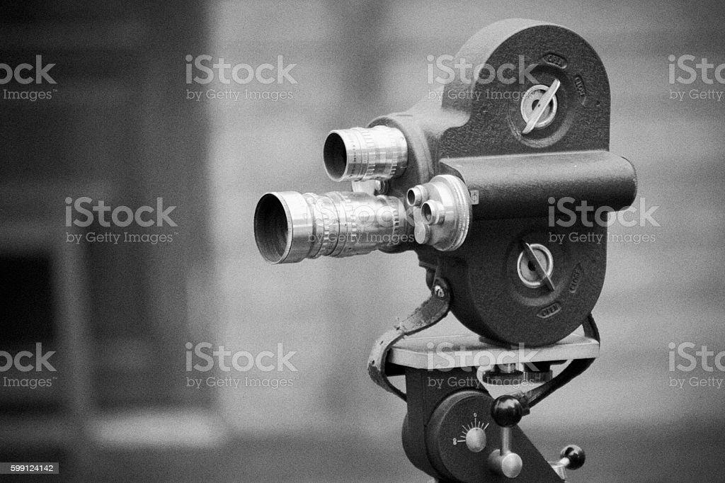 Retro movie camera on a tripod. stock photo