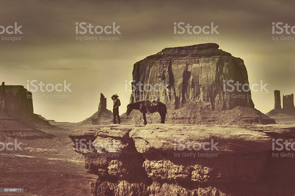 Retro Native American Cowboy in Southwest Monument Valley Tribal Park stock photo