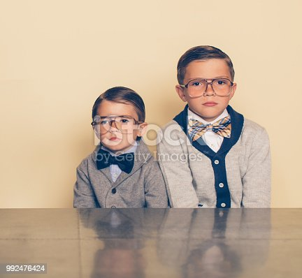 139880782istockphoto Retro Nerd Boys with Bored Expressions 992476424