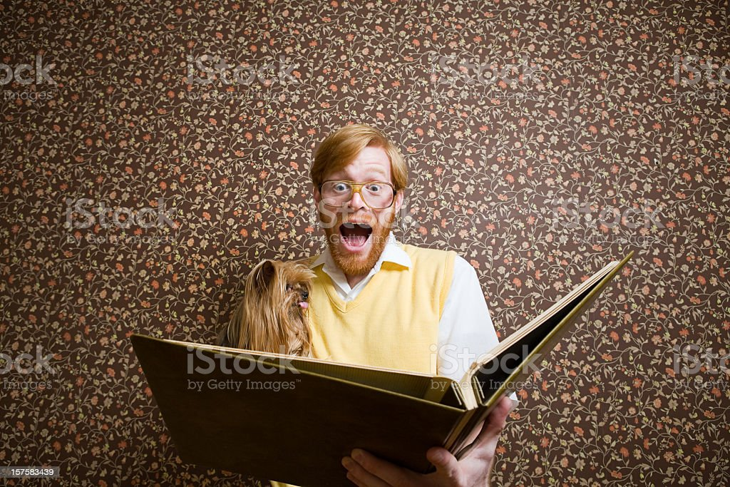 Retro Nerd with Dog and Book royalty-free stock photo