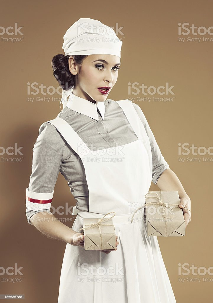 Retro nurse holding ration boxes royalty-free stock photo