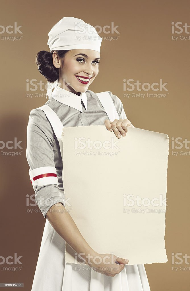 Retro nurse with announcement royalty-free stock photo