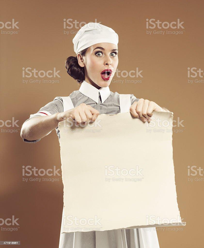 Retro nurse with banner royalty-free stock photo