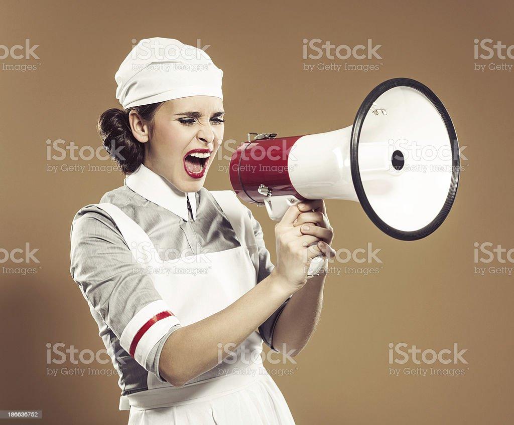 Retro nurse with megaphone stock photo