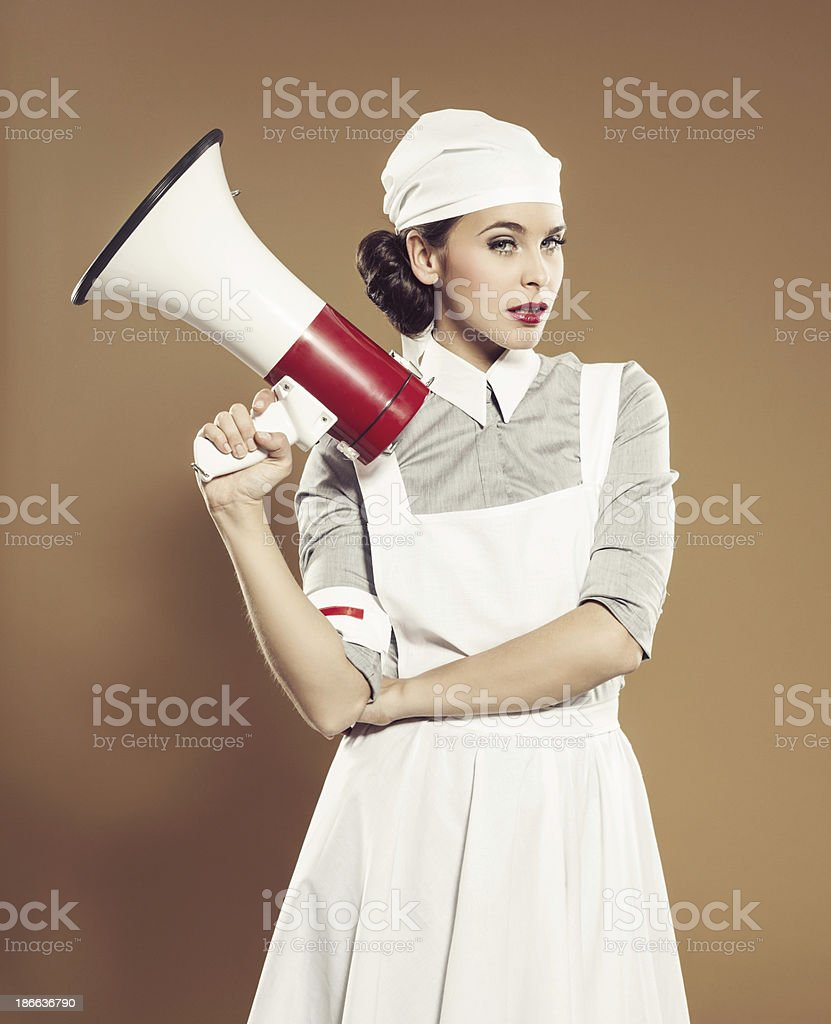 Retro nurse with megaphone royalty-free stock photo