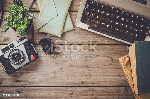 Retro objects on an old wooden table