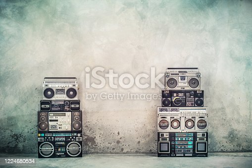 1043737676 istock photo Retro old design ghetto blaster boombox radio cassette tape recorders from 1980s front concrete street wall. Nostalgic Rap, Hip Hop, R&B music concept. Vintage style filtered photo 1224680534
