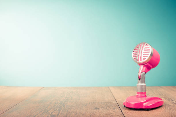 retro old microphone from 60s front mint green background. vintage style filtered photo - talk in a radio foto e immagini stock