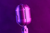 istock Retro Old Microphone, Vintage Style with Neon Lights 1145165800