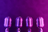 istock Retro Old Microphone, Vintage Style with Neon Lights 1145165897
