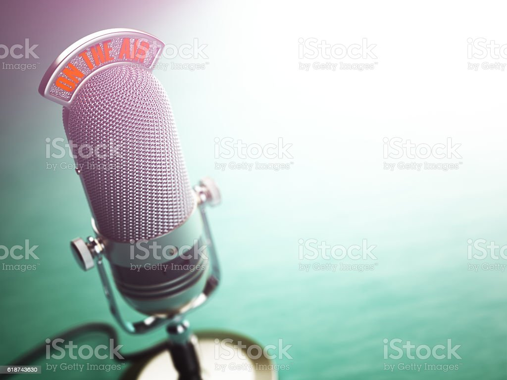 Retro old microphone with text on the air. Radio show - Photo