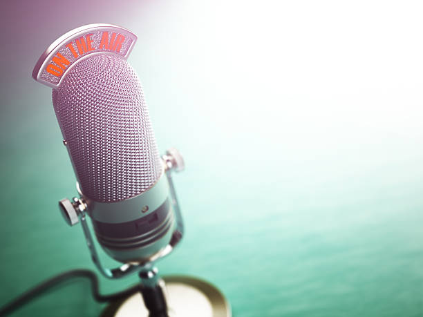 Retro old microphone with text on the air. Radio show stock photo