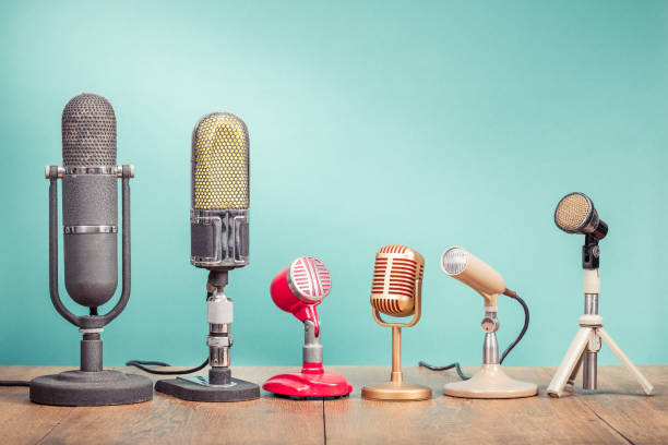 Retro old microphones for press conference or interview recording on table front gradient aquamarine background. Vintage old style filtered photo Retro old microphones for press conference or interview recording on table front gradient aquamarine background. Vintage old style filtered photo debate stock pictures, royalty-free photos & images