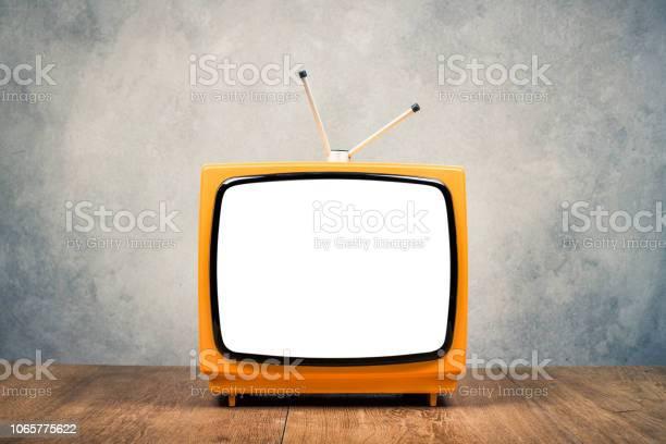 Retro old orange portable tv receiver frame on wooden table front picture id1065775622?b=1&k=6&m=1065775622&s=612x612&h=qctccfo2nbkqvfpxo8sqaxqz5yulgahq uzlbs5yhau=