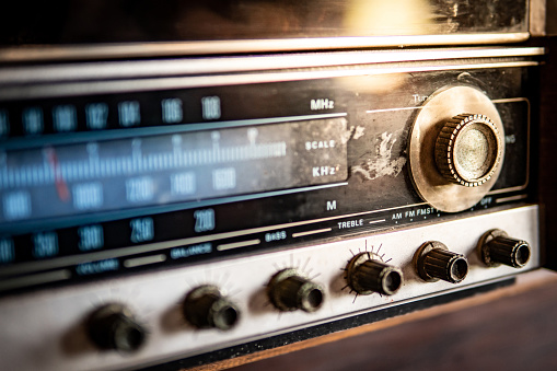 istock Retro old radio dashboard with rustic tuning button. Listen to music and news from broadcasting. Vintage lifestyle concept 1130938646