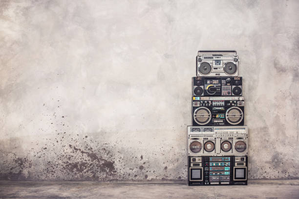 retro old school design ghetto blaster boombox stereo radio cassette tape recorders tower from circa 1980s front concrete wall background. vintage style filtered photo - rock music stock pictures, royalty-free photos & images