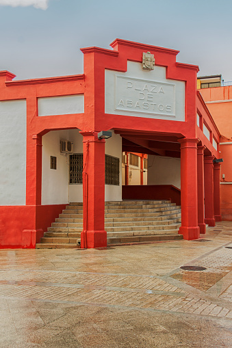 Plasencia,Spain - March 10, 2013: Exterior facade of the traditional food market painted with red paint.