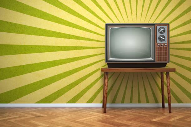 Retro old TV set on the vintage background. stock photo