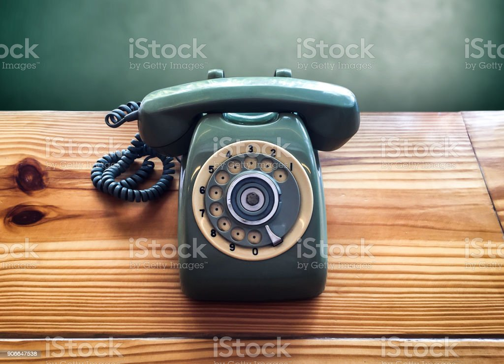 Retro old vintage telephone on wooden table, communication stock photo
