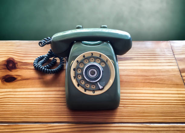 retro old vintage telephone on wooden table, communication - asian with phone house background stock photos and pictures