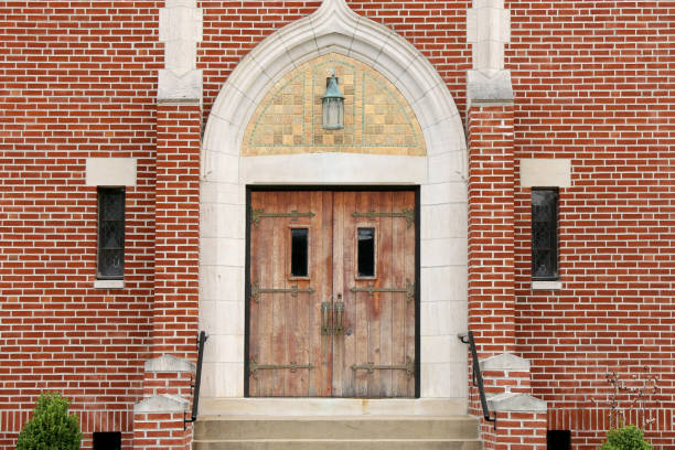 retro old wooded iron hinge brick church doors stock photo