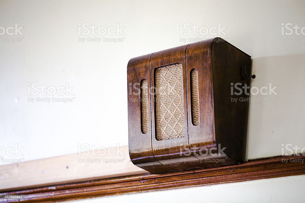retro old-fashioned tannoy loudspeaker on wall stock photo