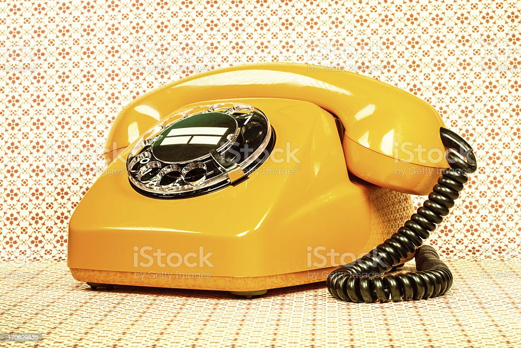 Retro orange telephone stock photo