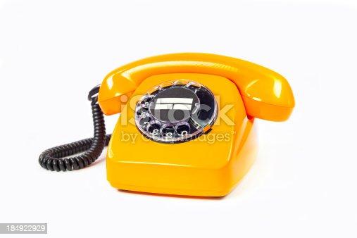 istock Retro orange telephone 184922929