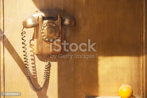 Retro phone in the booth. Telephone in the phone booth