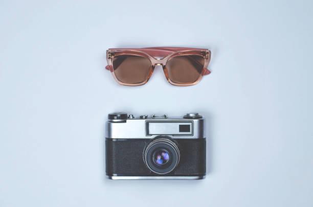 Retro photo camera and pink glasses on gray background picture id1157570208?b=1&k=6&m=1157570208&s=612x612&w=0&h=2do3ofgcww9ispa kj7khzdvhmqw4vo86wc7jbqhp90=