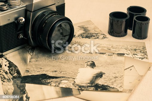 609706398 istock photo Retro photo camera with film rolls .Vintage stylized. 609706084