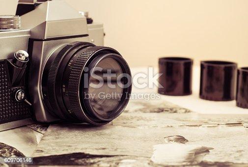 609706398 istock photo Retro photo camera with film rolls .Vintage stylized. 609706146