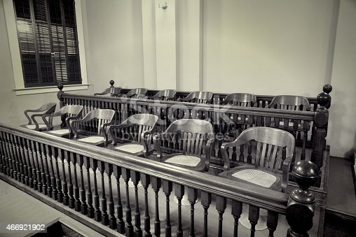 retro style photo of an old fashion jury section in a courtroom. A symbol of justice.