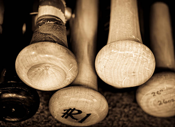 Retro photo of old baseball bats inscribed stock photo