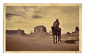 Retro Photo of Western Cowboy Native American with Horse at Monument Valley Tribal Park