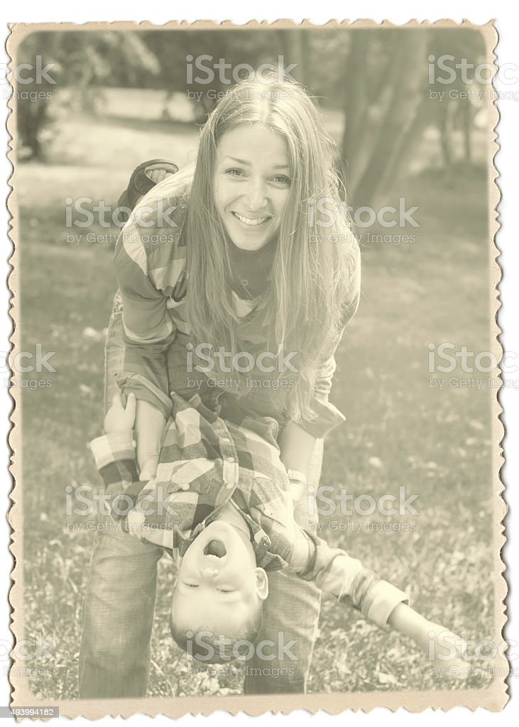 Retro Photo With Vintage Frame Mother And Son Have Fun Stock Photo
