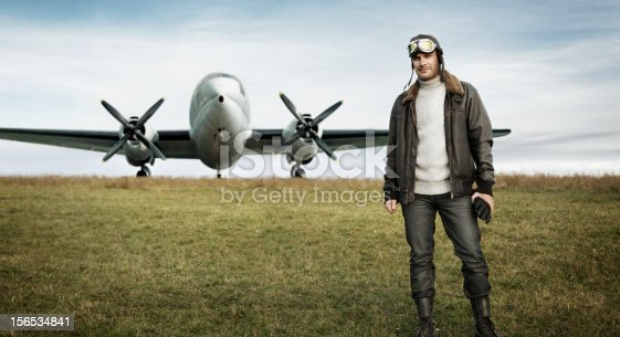 Retro pilot and his airplane. See my other similar photos: