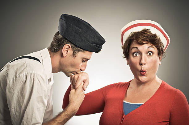 Retro Pilot Kissing Nurses Hand Retro Navy pilot kissing female nurses hand. Thanks to members stacey_newman & ohdub for posing. kissinghand stock pictures, royalty-free photos & images